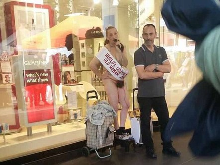 FERRARI PRESS AGENCY - 24/09/15 - Image of nearly naked Kay Bishop, 56, glued her bum to Debenhams in Croydon to protest about migrants and the police. Photo by @busrxoz - SEE FERRARI COPY